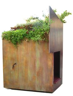 Frank Lloyd Wright-inspired dog house with green roof.  Thoughtful and gorgeous.