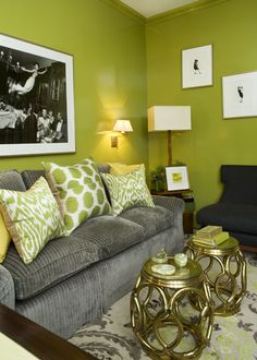 Amanda Nisbet's lyrical composition in multiple shades of yellow green on a gray and white rug with brass tables and yellow pillows.