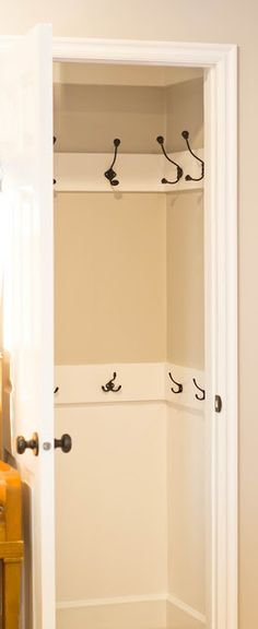 Good use of a small entry closet - rows of hooks (I would still put a shoe rack in the bottom area)