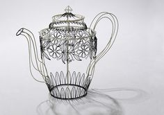 Wire sculpture flower watering can by Cathy Miles.