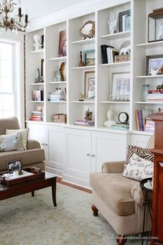 Living Room...Built in Bookshelves make a room seem larger..fewer pc's of furniture.