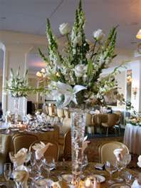 White roses, white oriental lily, and white dendrobium orchids.