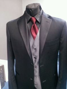 Black tux, black shirt, red tie, charcoal vest. Love this, with the black shirt. Nice silver tie though? With a dark purple vest?