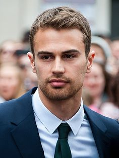 """Theo James [born Theodore Peter James Kinnaird Taptiklis; 16 December 1984; height 1.83m] is an English actor, known for portraying the role of Tobias """"Four"""" Eaton in the film adaptations of The Divergent Series. He played Jed Harper in the supernatural television series Bedlam (2011), Detective Walter William Clark, Jr. in the crime-drama series Golden Boy (2013), and David in the films Underworld: Awakening (2012) and Underworld: Blood Wars (2016)"""