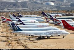 """Eight planes are 747s, five are MD-10s and three are 757s. Victorville-Southern California Logistics Airport November 14, 2014 Photo by: Tim Bowrey """"An overview of Victorville with far too many Queen's parked being stripped for parts with a new resident ZK-SUH nearest only retiring a short time ago and already looking like her flying days are over."""" [All she needs is a new set of engines and she probably could fly again.]"""