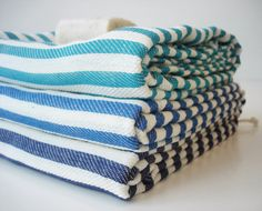 turkish bath towels via etsy shop bathstyle.  Could use fabric to re-cover chair?