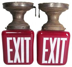 Two Ruby Glass Theatre Exit Signs