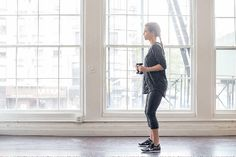 Start with your legs a little wider than shoulder-width apart, feet parallel and arms (holding 2-pound weights) pulled in close to the body with the elbows back. Squat by sitting back into your glutes while extending your arms forward. Return to starting position. Do 25 reps.
