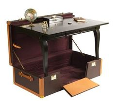 The writing desk trunk by EPHTÉE    This trunk is actually a study for a special order.    The table takes place in the top and the whole space of the trunk is free for your belongings.
