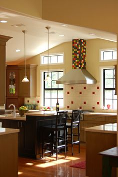 Colorful Kitchen, love  the tiles on the hood