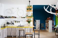 Interior:Open Paln Design For Large Design Room With Simple Kitchen Design With Yellow Cooktop And Stainless Steel Sink Also Utensils Hangin...