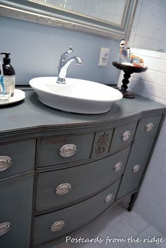 I love the colors and finish on this credenza-turns-bath vanity:  Benjamin Moore Regal Eggshell finish in Quarry Rock,  Minwax Chestnut gel stain   Modern Masters Dead Flat varnish
