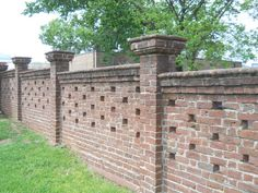 Example of brick wall piercing: I'd like to consider possible piercing in the brick wall facing the street, so that the wall would be less imposing. The key would be to decide on how much piercing. I'd lean towards more of a minimalist approach like this one.