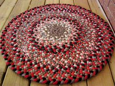 Handmade Gingerbread Wool Braided Round Rug in Gray by mrsginther