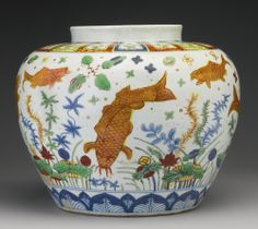 Side view of a section of a rare wucai 'fish' jar, Emperor Jiajing mark and period, Ming Dynasty.