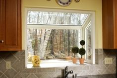 Kitchen garden windows can make a dark space seem brighter and small space seem larger. Window Over Sink, Kitchen Must Haves, Garden Windows, Dream House Plans, Kitchen Decor, Kitchen Ideas, Small Spaces, Sweet Home, New Homes