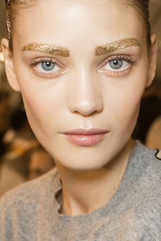 #pfw Dior Backstage makeup by Pat McGrath SS2014 #gold #eyebrows