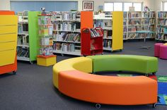 Our latest library make-over and it looks stunning. The staff at Campbell Primary School wanted to rejuvenate their library by adding colour, shapes and dimension to their library. By adding mobile shelving with a variety of exquisite bay-end panels we achieved a vibrant and 3D appearance. We created reading spaces by using their existing mats and added our bright curved ottomans. Browser boxes were added for extra storage and seating. Kink ottomans allow the students flexible seating in any…