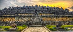 Borobudur,  Dieng plateau Java. Late 8th century C.E. The monument is oriented to four cardinal directions. It is allinged vertically with Mahayana cosmology. It is carved of volcanic lava stones. It's thought to be an image of the  universe with 72 stupas, and one giant one at the top.
