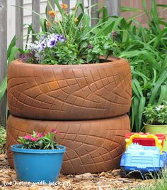 Flower planter ideas... including an old tire planter and other easy planter ideas.