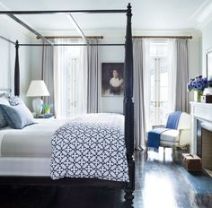 In the master bedroom of Brooke Shields's Manhattan townhouse, an Edwardian oil portrait that was purchased in London accents the wall | archdigest.com