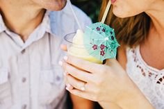 This adorable couple shared a Dole Whip during their Disneyland engagement session- now that's true love!