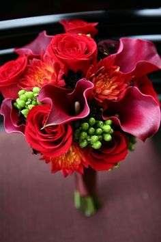 My wedding bouquet - red calla lillies, red roses, red dahlias, brown cosmos, and those green berries.