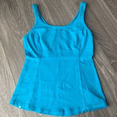 Lululemon tank This is a nice thick material with an internal key pocket in the lower part of the shirt. Authentic Lululemon size 4. Feel cool and dry in this for the sweatiest of workouts. lululemon athletica Tops Tank Tops
