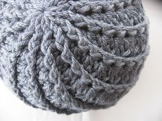 The front post dc and shell stitch combination in this Divine hat really caught my eye. The pattern uses asymmetrical shells to force the front post stitches in one direction, making the spiral . Spiral Crochet, Knit Or Crochet, Crochet Crafts, Yarn Crafts, Crochet Stitches, Crochet Projects, Free Knitting, Knitting Patterns, Crochet Patterns