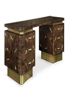 "Baraka is an ancient Sufi word which means ""a blessing – the breath of life -, or essence of life"" from which the evolutionary process unfolds. Charismatic by its never-ending contrasts between ancient and contemporary lines, BARAKA Desk main body is made in matte walnut root veneer and covered with nature-inspired brass detail. Its base is made in matte vintage brass, and the interior of the drawers covered in bird's eye wood veneer. This desk is a fierce choice for any office room."