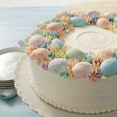 Soft pastel colors make this springtime cake just as beautiful as it is delicious. Simple and classic, this lovely spring cake is sure to be the crowning touch to your Easter brunch.