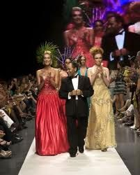 Andres Aquino  takes to the runway to thank the press and audience during the final parade of his show
