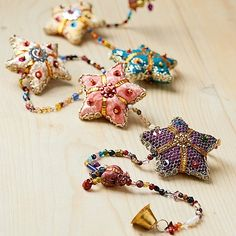 £9.99 A bright garland of fabric stars with metal bells, sequin and plastic and glass bead details; echoing the opulent, embellished embroidery in traditional Ari work.