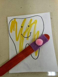 the kids brushed their tooth (laminated paper colored with yellow dry erase) Popsicle stick felt for the brush
