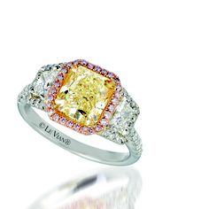 This all natural beauty from Le Vian Couture is a Platinum masterpiece with an elongated cushion cut Sunny Yellow Diamond with a halo of natural Orchid Pink Diamonds sided with a pair of trapezoid VS Vanilla Diamonds and outlined meticulously with a micro pave of diamonds. A one of a kind, built around the rare diamonds selected for it. Unique pieces like this can be found in our trunk shows in US UK and Canada.