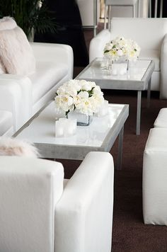 Coffee tables topped with fresh blooms and candles are essential, allowing guests to put down their cocktails and speak freely.