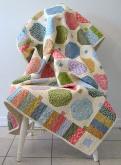 scrappy snowball quilt tutorial @Carol Ray, this one would be simple to make too.