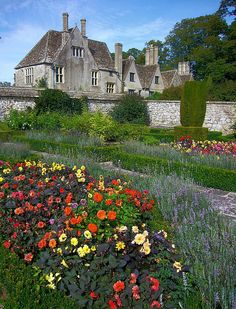 16th century Avebury Manor and Gardens by flash of light. Wiltshire, England