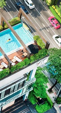 Take a dip in the outdoor rooftop pool to cool off with skyline views in Bangkok, Thailand.