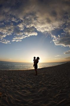 Silhouette photography at the beach with a fisheye lens. H. Parker Photography