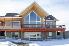 Feel like the king of the mountain in your own mountain lodge with two story windows geared to take advantage of your views.On the main level, lots of open decks provide space to sit and enjoy the views and the sun.The focal point of the great room is the warm fireplace where you can relax and enjoy the views from the two-story windows.Windows surround the dining room with light and close proximity to the kitchen makes serving a breeze.Two walk-in closets and a spa bath pamper the owners who…