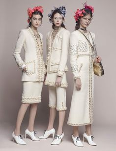 Chanel. (And better without the head gear - which would be great with other outfits, not these)