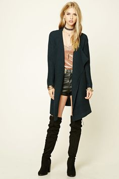 Style Deals - This longline cardigan features a purl knit, an open draped front, long sleeves, and ribbed trim.