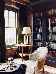 rustic-office-library-new-york-new-york-200701_1000-watermarked This dark, cozy Manhattan home belonging to Carter Smith. loft apartment
