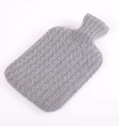A perfect gift or even better for a little self indulgence. This beautifully crafted, seamlessly knitted, hot water bottle cover is perfect for keep warm on those cold dark nights. Made from 100% Cashmere in a range of fantastic colours. Includes 2 litre hot water bottle.