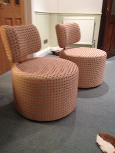Twice as much fun - these two swivel chairs have been covered in Harlequin's Polka fabric.