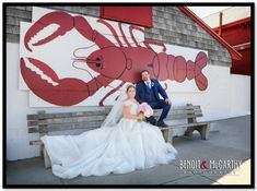 Bride & Groom Chillin with the Giant Lobster in Essex in front of Woodman's!   #essexroom #weddingphotography #benoit&mccarthyphotography #northshoreweddings