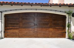 Boring metal garage door after a little stain and some wrought iron trim.