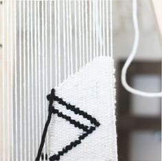 Weaving shapes sans color is a great way to keep a design bold and modern.  To me, I like to imagine that the tapestry is a blank piece of paper with  black sketches drawn right ontop. Although I chose to use a thicker roving  for my outlines, a thin material would also look great. Below I hace