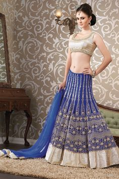 Awesome blue & silver lehenga choli - This lehenga choli in blue and silver color is crafted in net material. Heavy thread embroidery work on lehenga enhance it's the overall look. Choli is enhanced with katdana and thread work in lovely pattern.